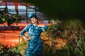 """Постер, картина, фотообои """"Великолепная молодая женщина в голубом платье в тюрбане в оранжерее"""""""