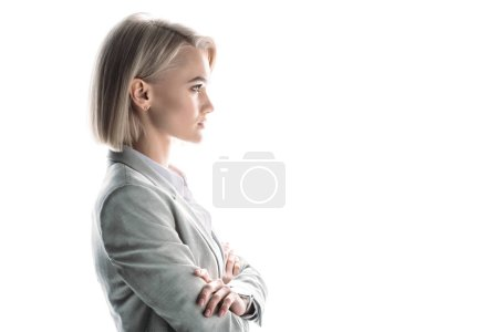 Photo for Side view of confident attractive businesswoman with crossed arms isolated on white - Royalty Free Image