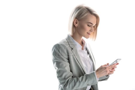 Photo for Attractive, smiling blonde businesswoman using smartphone isolated on white - Royalty Free Image