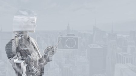 Photo pour Double exposure of businesswoman using smartphone and new york cityscape - image libre de droit