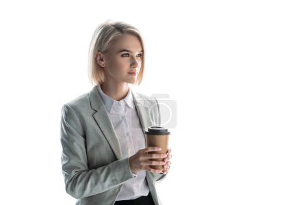 Photo for Beautiful, pensive businesswoman holding paper cup and looking away isolated on white - Royalty Free Image