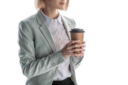 Photo for Partial view of businesswoman holding coffee to go isolated on white - Royalty Free Image