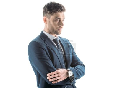 Photo for Handsome, confident businessman with crossed arms looking away isolated on white - Royalty Free Image
