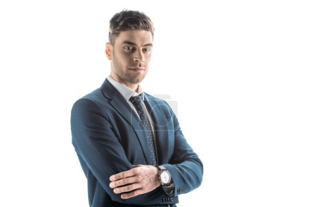 Foto de Good-looking, confident businessman with crossed arms looking at camera isolated on white - Imagen libre de derechos