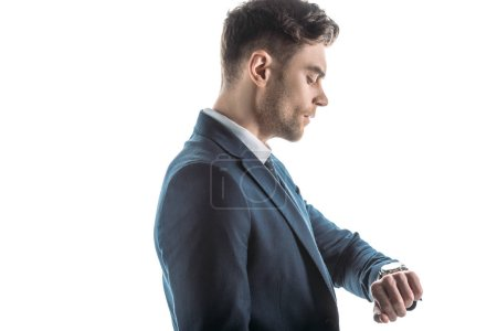 Photo for Handsome, confident businessman looking at watch isolated on white - Royalty Free Image