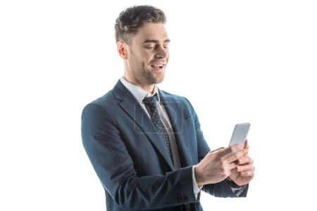 Photo for Handsome, cheerful businessman using smartphone isolated on white - Royalty Free Image