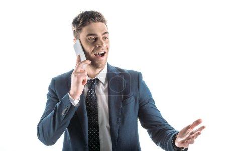 Photo pour Beau, homme d'affaires joyeux en utilisant smartphone et geste isolé sur blanc - image libre de droit