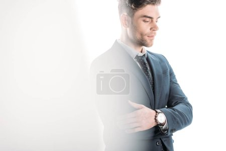 Photo for Selective focus of confident businessman with crossed arms on white - Royalty Free Image