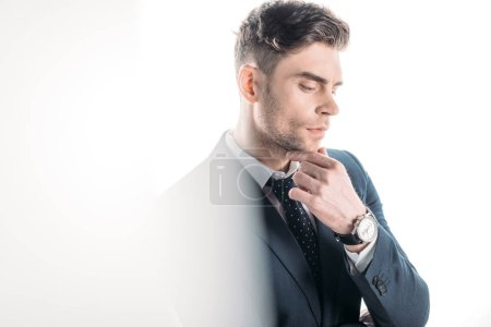 Photo for Selective focus of handsome, thoughtful businessman in suit on white - Royalty Free Image