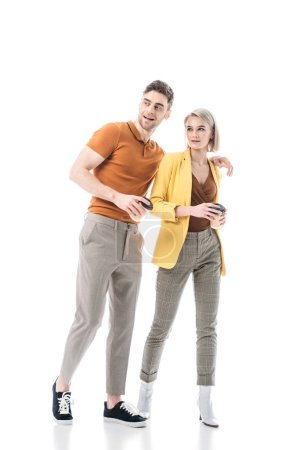 Photo for Smiling young man and woman holding coffee cups while standing together isolated on white - Royalty Free Image