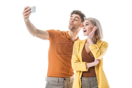 Photo pour Cheerful young man an d woman taking selfie with smartphone isolated on white - image libre de droit