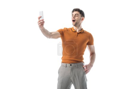 Photo for Cheerful handsome man taking selfie with smartphone isolated on white - Royalty Free Image