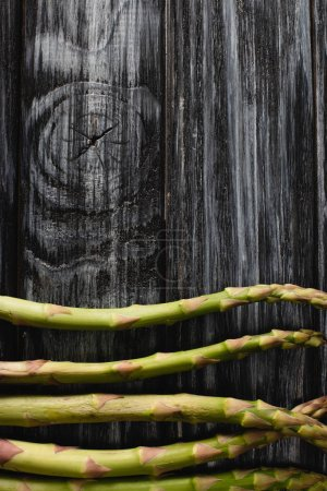 top view of fresh green asparagus on wooden table