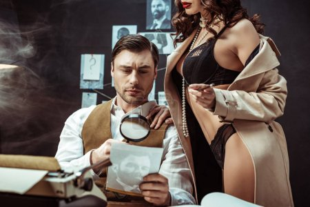 Photo for Cropped view of sexy woman in lingerie and trench coat seducing detective in office - Royalty Free Image