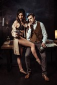 Sexy woman in lingerie and trench coat seducing detective in office