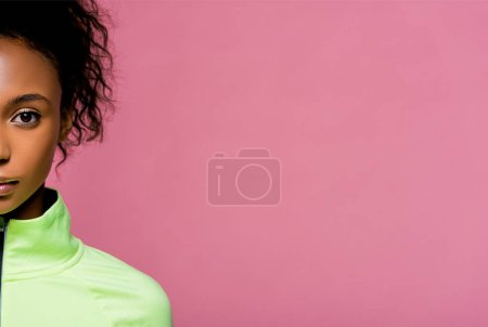Photo for Cropped view of beautiful african american sportswoman looking at camera isolated on pink with copy space - Royalty Free Image