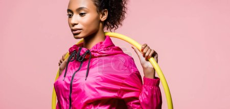Photo for Panoramic shot of beautiful african american sportswoman posing with hula hoop isolated on pink - Royalty Free Image