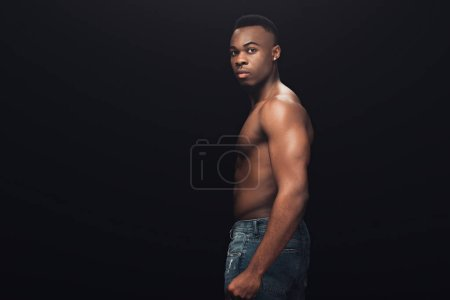 Photo for Handsome shirtless african american man in denim looking at camera isolated on black with copy space - Royalty Free Image