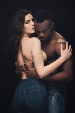 Photo for Beautiful sensual half-naked interracial couple embracing isolated on black - Royalty Free Image