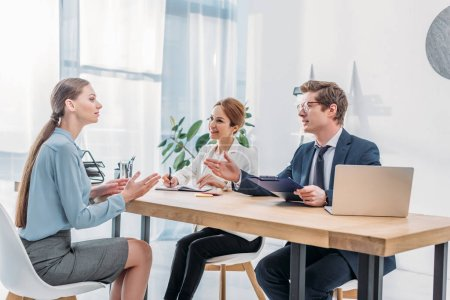 Photo for Attractive woman speaking with recruiters during job interview - Royalty Free Image