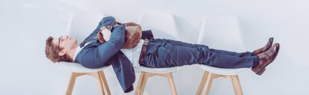 Photo for Panoramic shot of employee lying on chairs while waiting job interview - Royalty Free Image