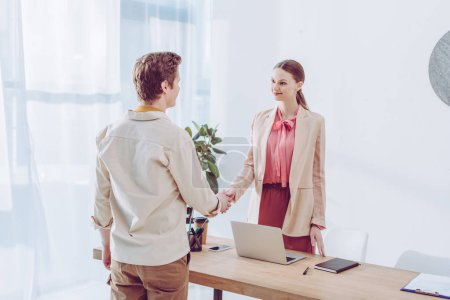 Photo for Cheerful employee shaking hands with recruiter in office - Royalty Free Image