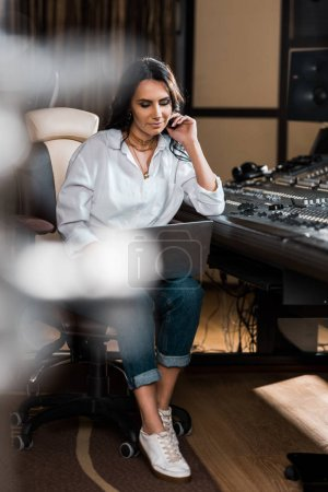Photo for Selective focus og thoughtful sound producer using laptop in recording studio - Royalty Free Image