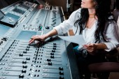 "Постер, картина, фотообои ""cropped view of sound producer working in recording studio at mixing console"""