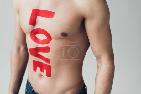 Photo pour Cropped view of shirtless man with inscription on body isolated on grey - image libre de droit