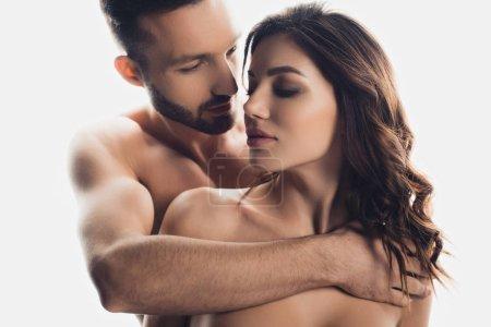 Foto de Handsome bearded man embracing nude girlfriend isolated on white - Imagen libre de derechos