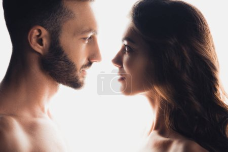 Foto de Side view of couple looking at each other isolated on white - Imagen libre de derechos