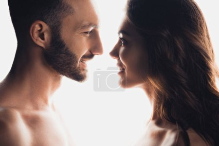 Photo for Side view of couple looking at each other isolated on white - Royalty Free Image