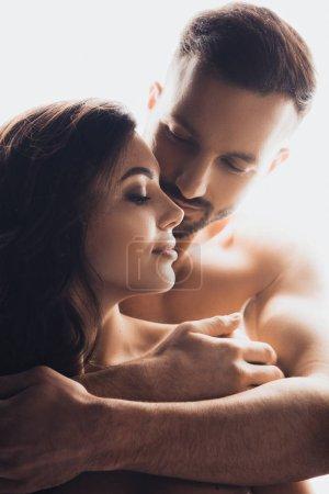 Foto de Bearded handsome man embracing girlfriend isolated on white - Imagen libre de derechos