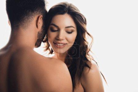 Foto de Smiling nude young woman with boyfriend isolated on white - Imagen libre de derechos