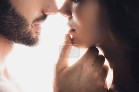 Photo for Cropped view of man gently touching girlfriend isolated on white - Royalty Free Image