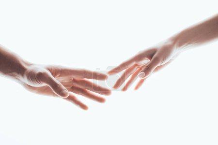 Photo pour Foyer sélectif des mains féminines et masculines isolées sur blanc - image libre de droit