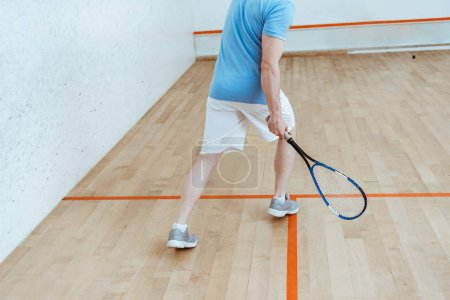Photo for Cropped view of sportsman in white shorts playing squash - Royalty Free Image
