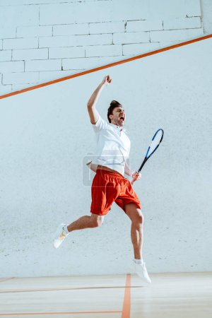 Photo for Full length view of happy squash player with racket showing yes gesture - Royalty Free Image