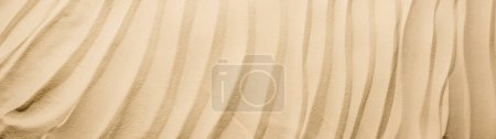 Photo pour Panoramic shot of background with textured sand and copy space - image libre de droit