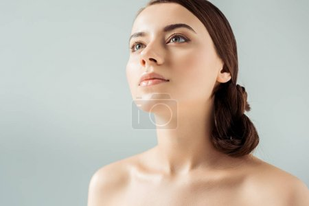 Photo for Young attractive woman with shiny lips and golden eye shadow isolated on grey - Royalty Free Image
