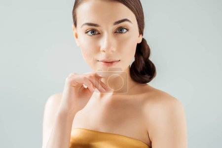 Photo pour Young smiling woman with shiny lips and golden eye shadow isolated on grey - image libre de droit