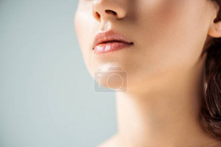 Photo for Cropped view of young woman with shiny lips on grey background - Royalty Free Image