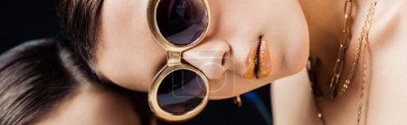 Foto de Panoramic shot of young naked woman in sunglasses, golden necklaces lying on mirror - Imagen libre de derechos