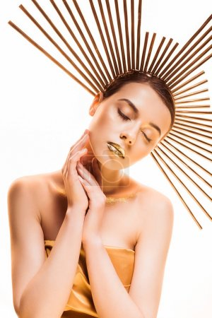 Foto de Young beautiful woman with closed eyes, golden makeup and accessory on head isolated on white - Imagen libre de derechos