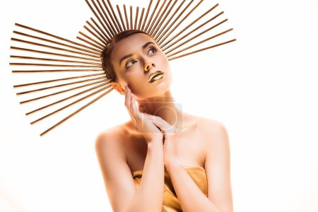 Photo pour Young dreamy beautiful woman with golden makeup and accessory on head looking away isolated on white - image libre de droit