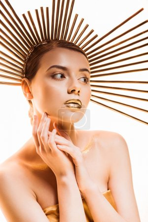 Photo pour Young beautiful woman with golden glittery makeup and accessory on head isolated on white - image libre de droit