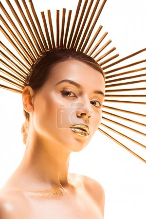 Photo pour Young nude beautiful woman with golden makeup and accessory on head looking at camera isolated on white - image libre de droit