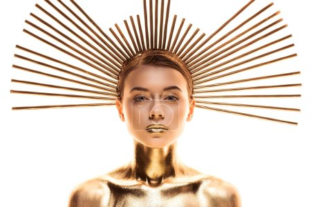Photo for Nude young woman painted in golden with accessory on head looking at camera isolated on white - Royalty Free Image