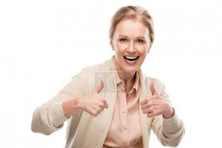 Photo for Excited middle aged woman showing thumb up signs Isolated On White - Royalty Free Image