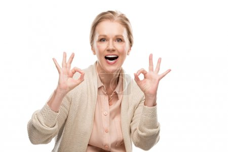 Photo for Excited middle aged woman showing ok signs Isolated On White - Royalty Free Image